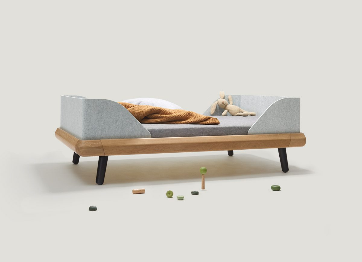 The VII frame junior bed made of solid oak grows with your child