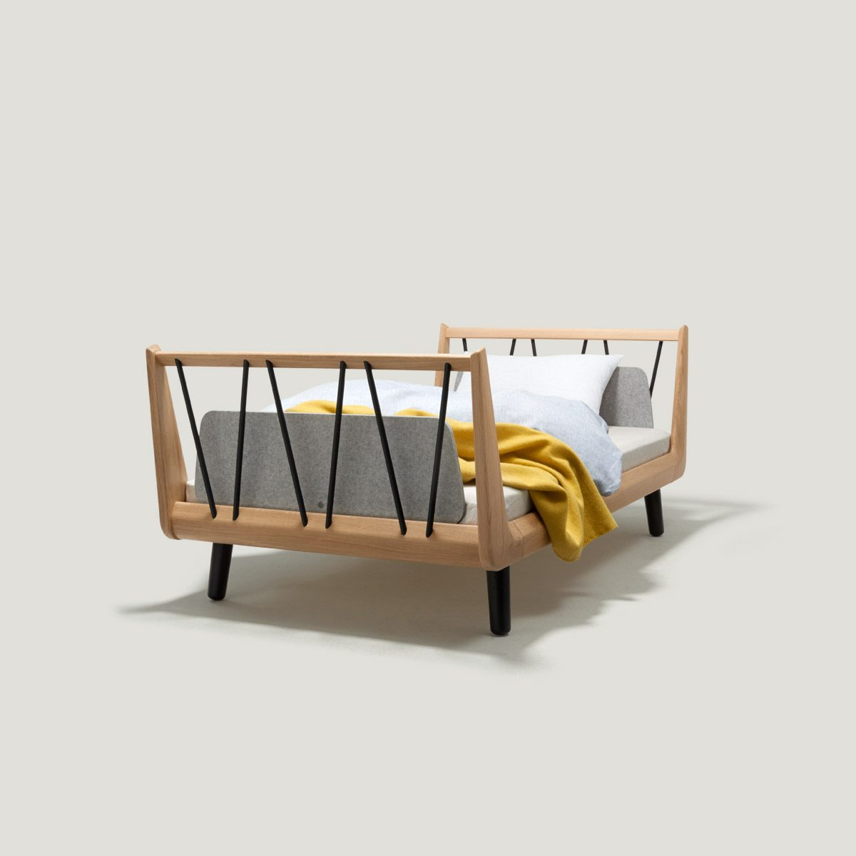 The VII classic junior bed – made from solid oak wood.