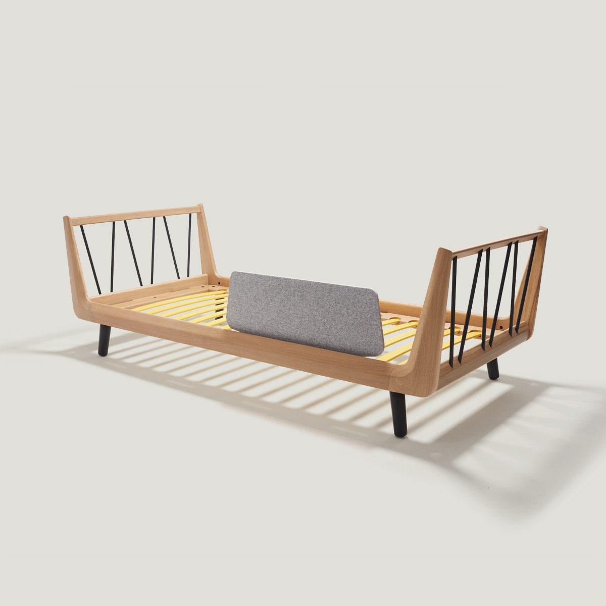 VII classic single bed – made of solid oak wood.
